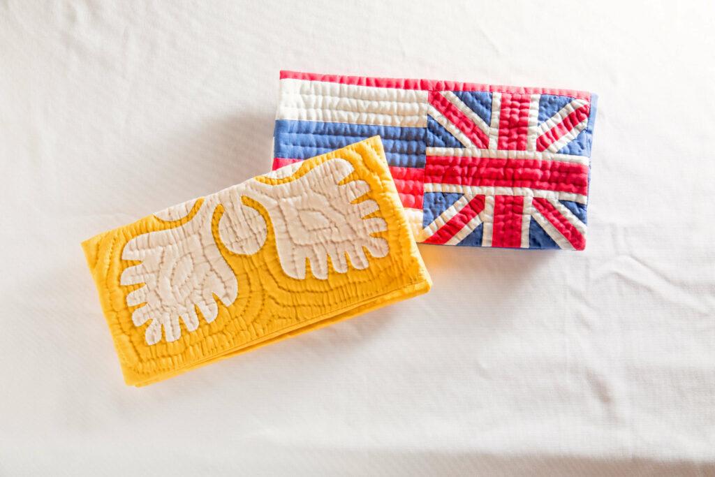 ハワイ州旗デザインとウルがモチーフのクラッチバッグ